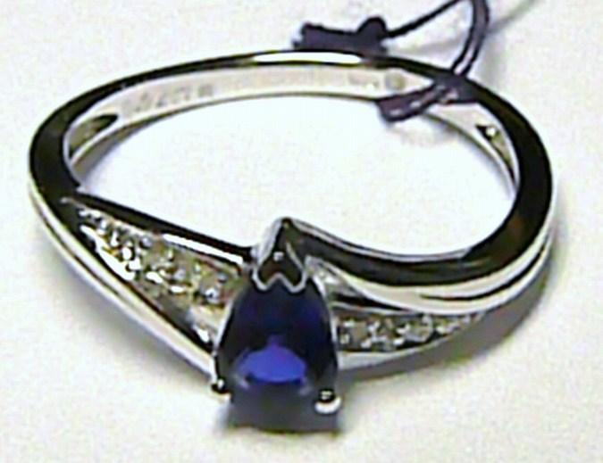Diamantový prsten z bílého zlata s velkým modrým safírem 585/2,0g - safír 0,49ct