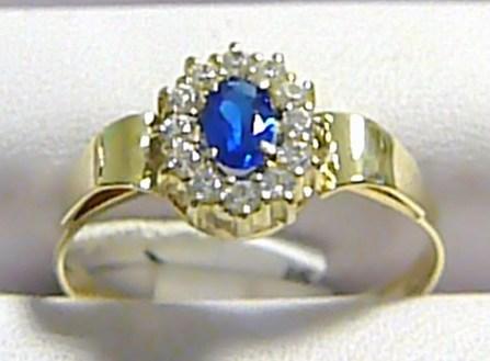 Mohutný dámský prstýnek s modrým safírem a zirkony 585/2,12 gr vel.58 P259